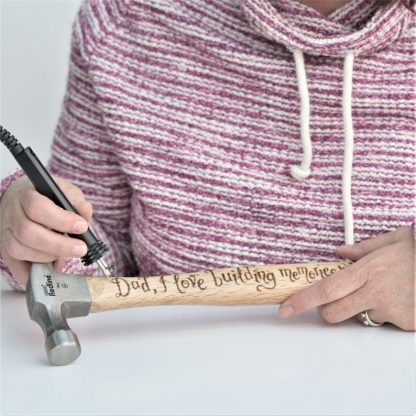 cove calligraphy engraving a hammer