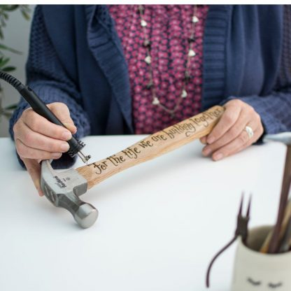 cove calligraphy hand engraving a personalised hammer for 5th anniversary