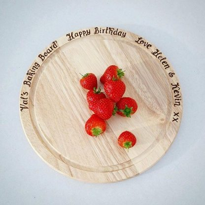 Personalised Chopping Boards, hand engraved with your choice of message, ideal wooden anniversary gift for a Bake Off fan
