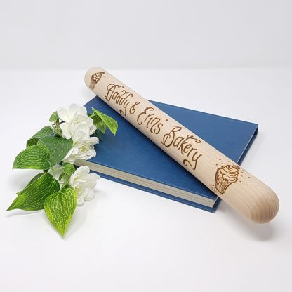 daddy and erins bakery wooden rolling pin with cupckaes angle prop sq