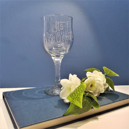 hand engraved wine glass personalised with any message in calligraphy font