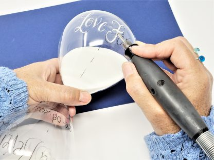 packing a hand engraved hourglass sand timer