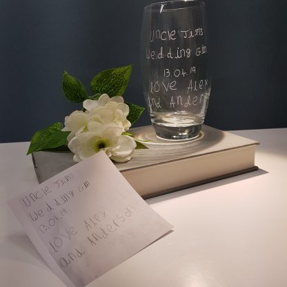 handwriting copied and engraved by hand onto highball glass