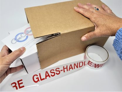 packing a glass trinket box hand engraved