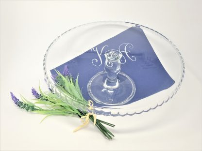 two initials on glass cake stand